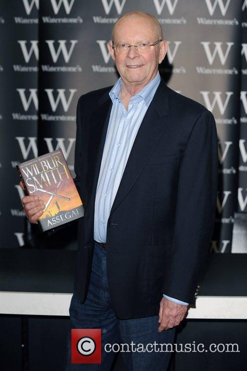 Wilbur Smith signs copies of his new book...