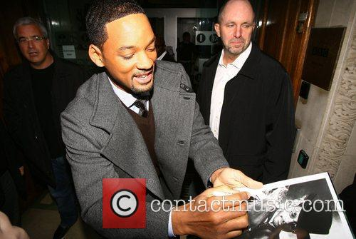 Will Smith signs autographs for fans as he...