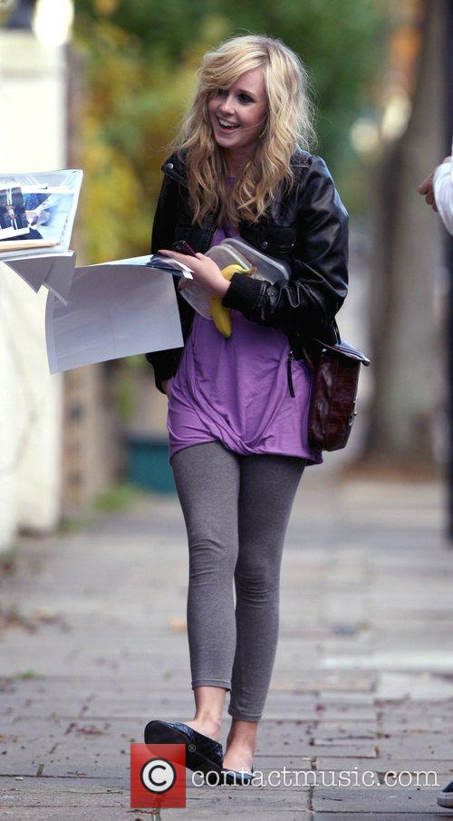 Diana Vickers laughs as she signs autographs for...