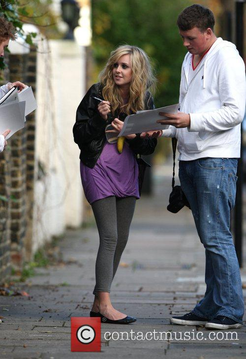 Diana Vickers signs autographs for fans near the...