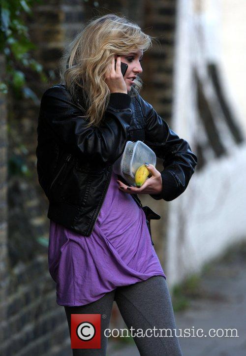 Diana Vickers talking on the phone and carrying...