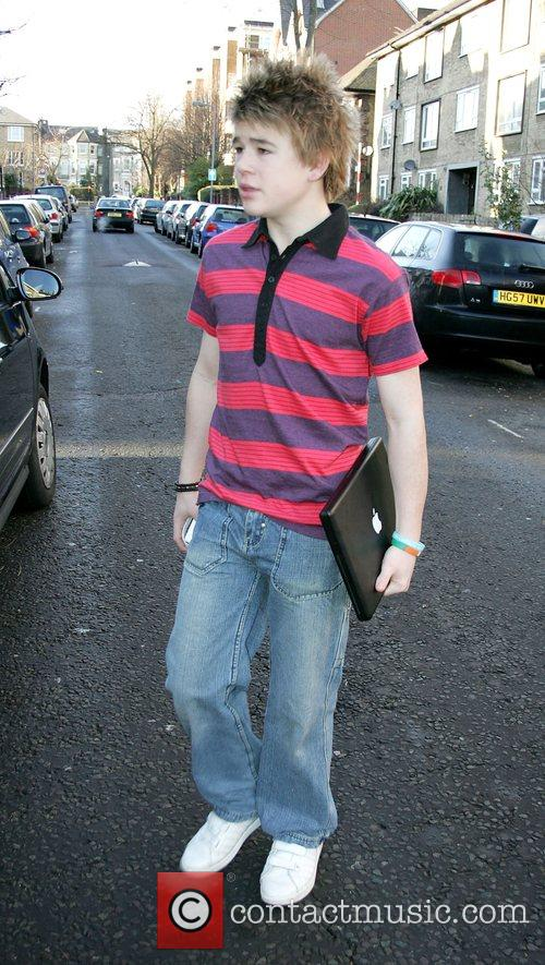 Eoghan Quigg  leaving the 'X Factor' house...