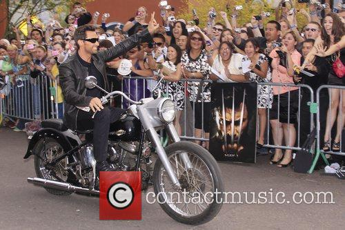 Hugh Jackman arrives by motorcycle at the World...