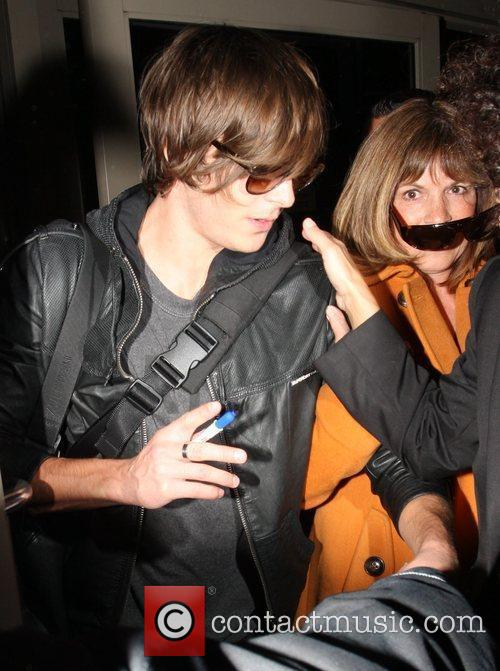Zac Efron and his mother arrive at LAX on a BA flight from London. 10