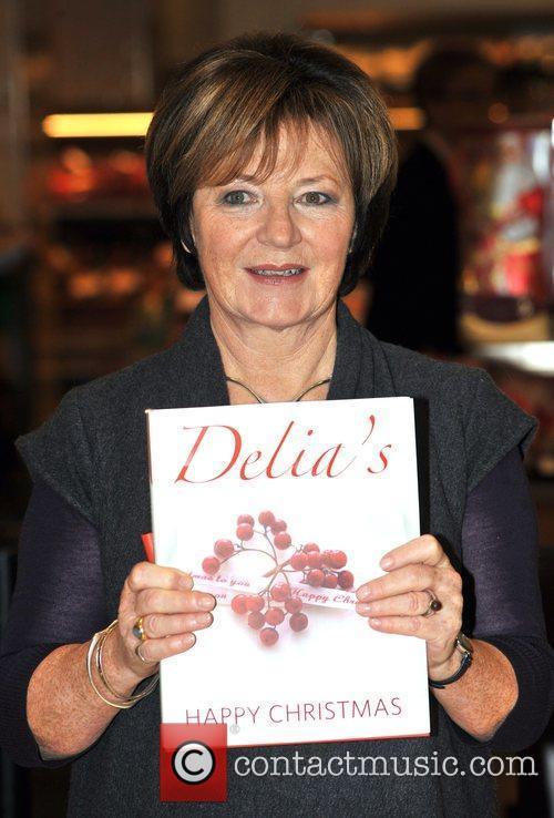 Delia Smith signs her latest book 'Delia's Happy...