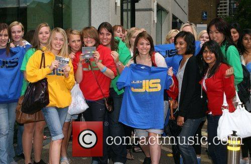 JLS fans wait outside the ITV studios for...