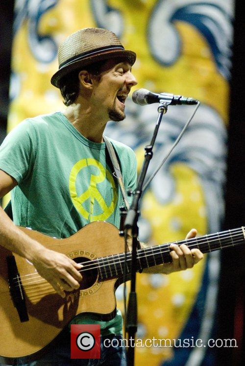 Jason Mraz performing on stage During The Gratitude...