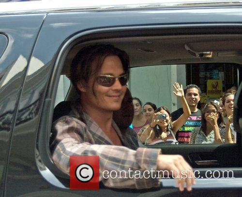 Johnny Depp arrives on the set of his...