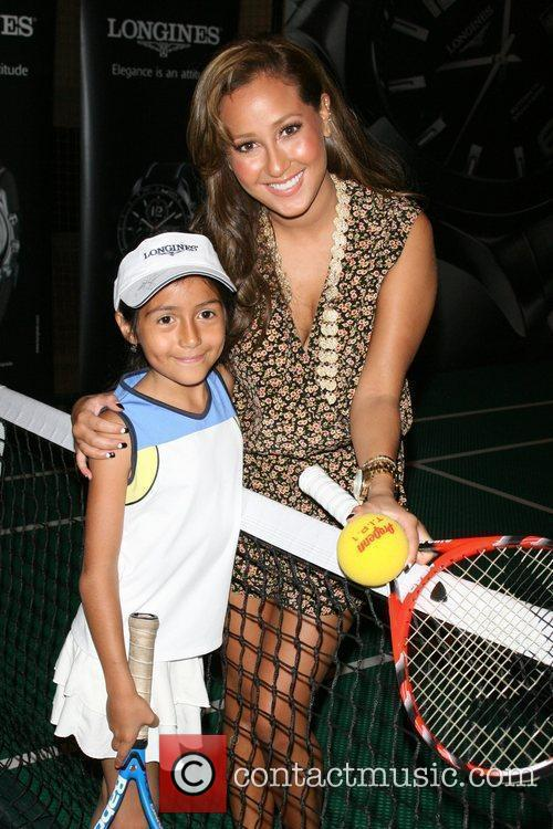 Adrienne Bailon and a young tennis player Children...