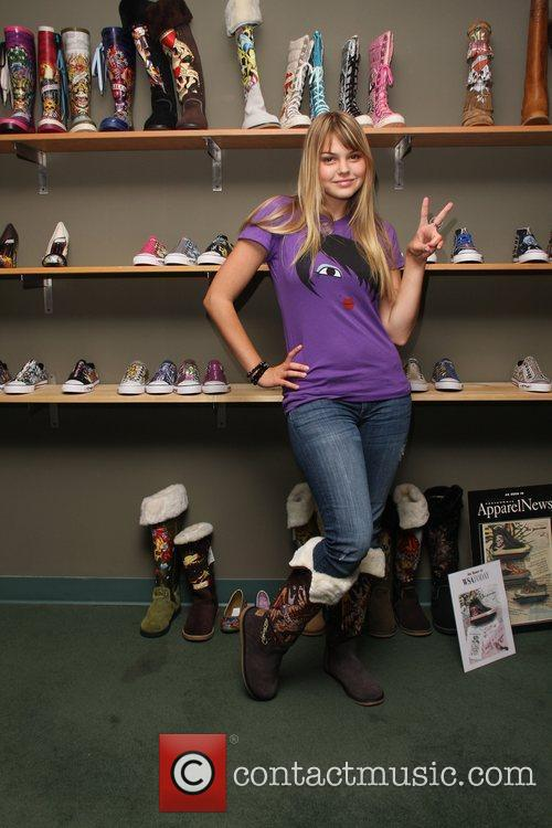 Aimee Teegarden visits an Ed Hardy Outlet Los...