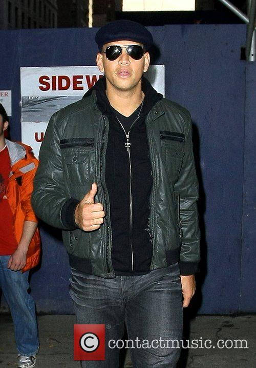 Alex Rodriguez gives a thumbs up as he...