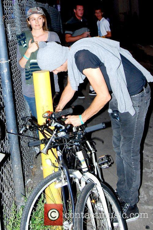 Unlock their bicycles from behind the El Capitan...