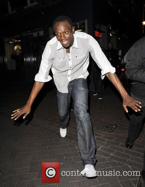 Usain Bolt Gives Photographers The Run Around As He Leaves Alto Nightclub With Friends 5
