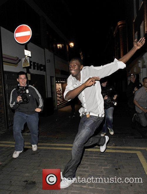 Usain Bolt Gives Photographers The Run Around As He Leaves Alto Nightclub With Friends 8