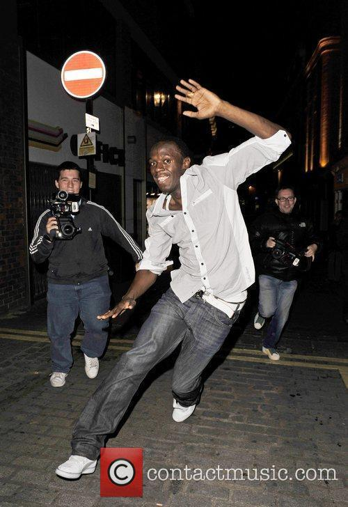 Usain Bolt Gives Photographers The Run Around As He Leaves Alto Nightclub With Friends 6