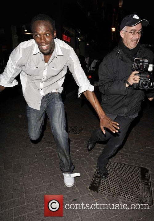 Usain Bolt Gives Photographers The Run Around As He Leaves Alto Nightclub With Friends 4