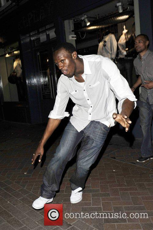 Usain Bolt Gives Photographers The Run Around As He Leaves Alto Nightclub With Friends 9