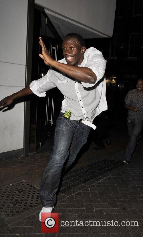Usain Bolt gives photographers the run around as...