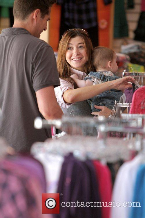 Alyson Hannigan and daughter Satyana Denisof shopping at...