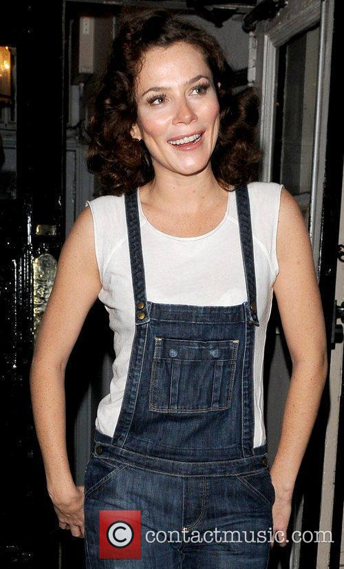 Leaving the Theatre Royal wearing dungarees after her...