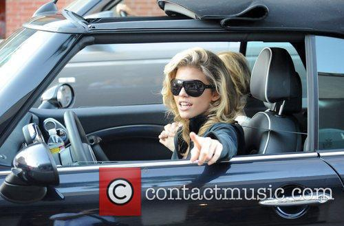 AnnaLynne McCord and her sister are mobbed by photographers as they drive through Beverly Hills in her Mini Cooper 15