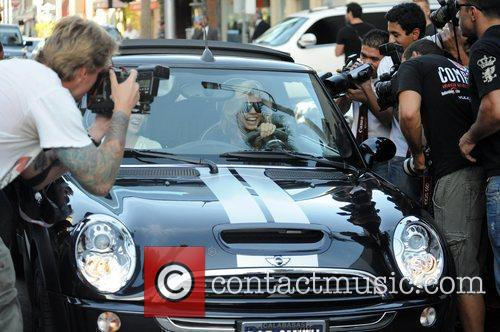 AnnaLynne McCord and her sister are mobbed by photographers as they drive through Beverly Hills in her Mini Cooper 16