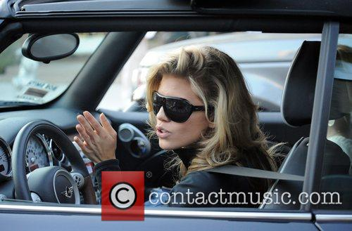 AnnaLynne McCord and her sister are mobbed by photographers as they drive through Beverly Hills in her Mini Cooper 14