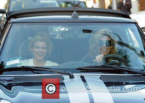 AnnaLynne McCord and her sister are mobbed by photographers as they drive through Beverly Hills in her Mini Cooper 17