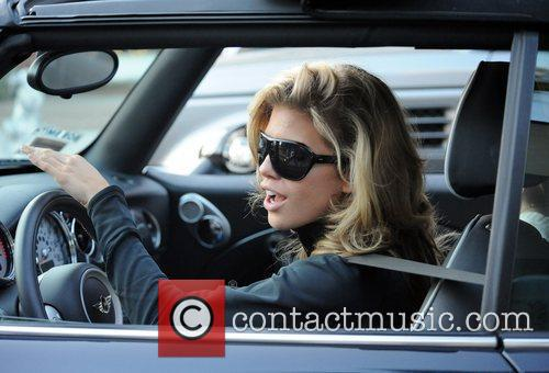 AnnaLynne McCord and her sister are mobbed by photographers as they drive through Beverly Hills in her Mini Cooper 12