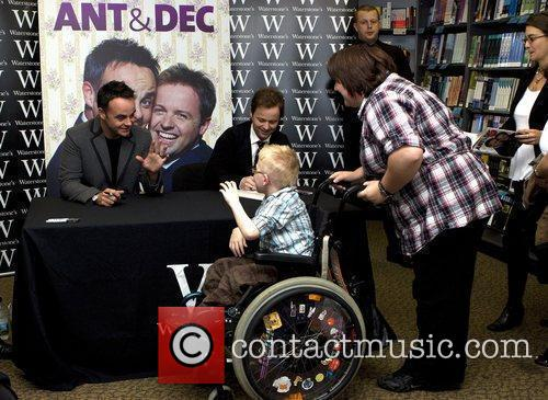 Ant and Dec sign copies of their new...