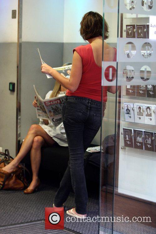 Yasmina Siadatan and Kate Walsh reading newspapers after...