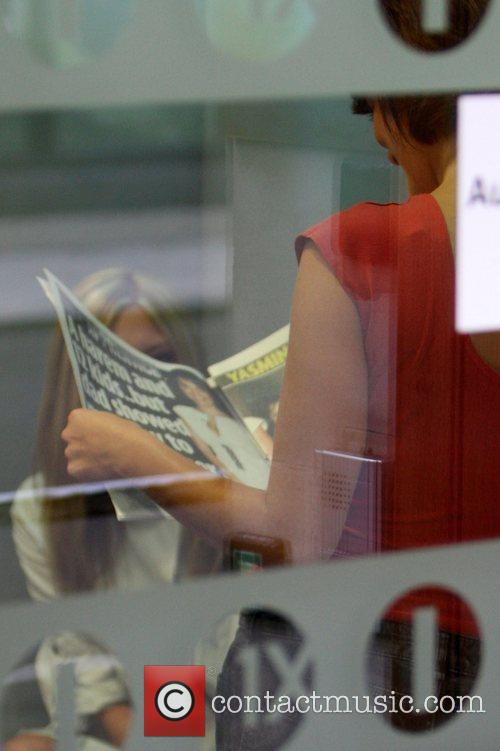 Yasmina Siadatan  reading a newspaper article about...