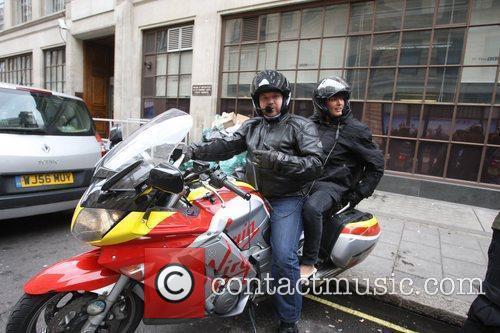 Yasmina Siadatan prepares to ride off on a...