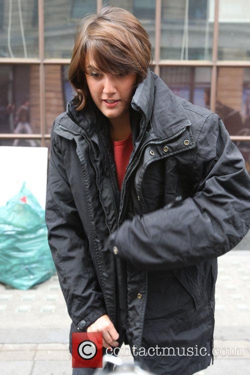 Yasmina Siadatan puts on protective biking gear whilst...