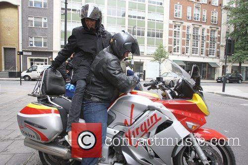 Yasmina Siadatan mounts a Virgin taxi bike as...