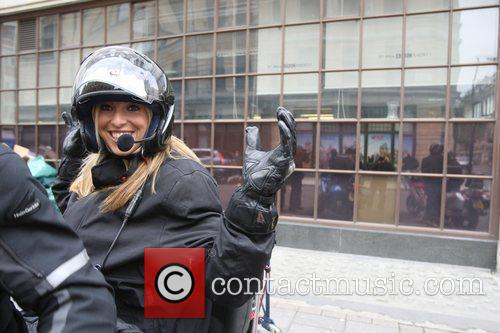 Kate Walsh prepares to ride off on a...