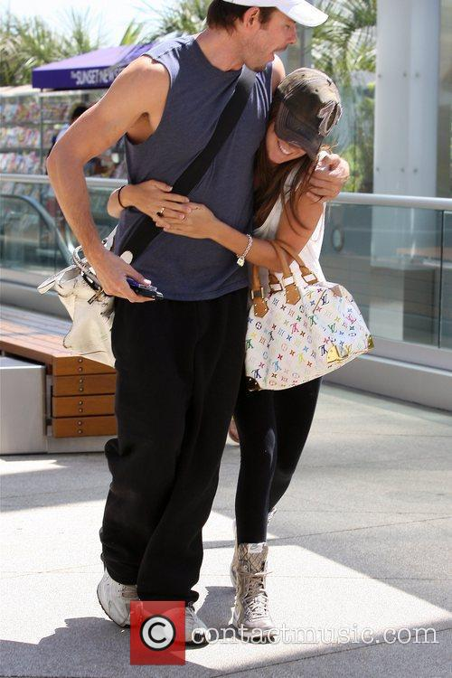 Ashley Tisdale jumps with excitement when she greets...