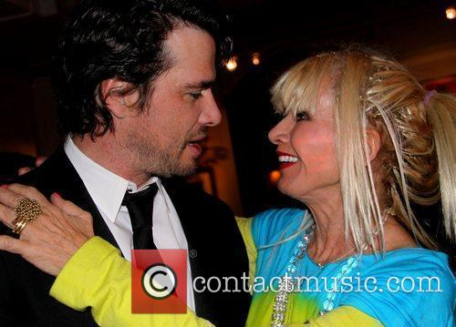 Matthew Settle and Betsey Johnson