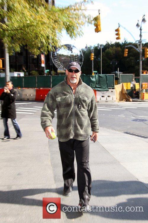 American professional wrestler and actor Bill Goldberg eating...