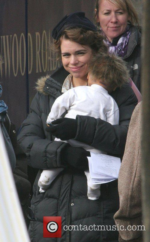 Billie Piper  holding a doll as a...