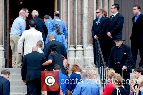 Atmosphere Mourners gather for the funeral of pitchman...