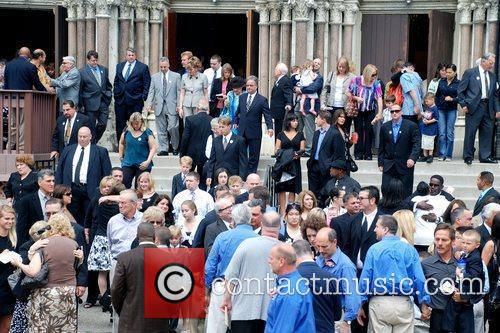 Mourners gather for the funeral of pitchman Billy...