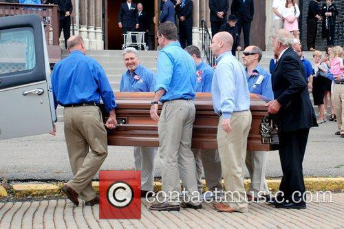 Pallbearers carry the casket of Billy Mays Mourners...