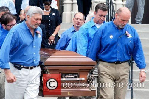 Pallbearers carry the casket of Billy Mays, including...
