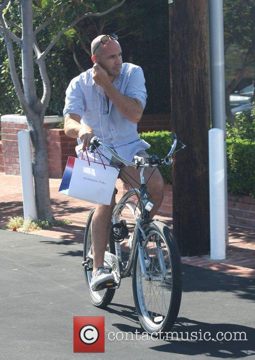 Billy Zane, wearing very short cut off shorts,...