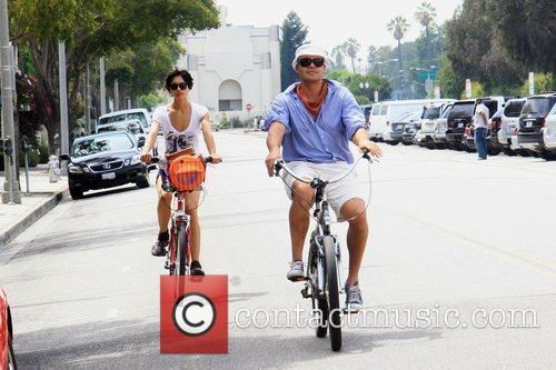 And his girlfriend ride bicycles in Beverly Hills