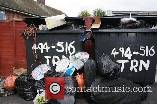 Bins overflow  as the refuse collection strike...