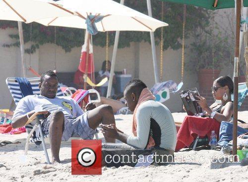 Bobby Brown and Alicia Etheridge on Malibu Beach