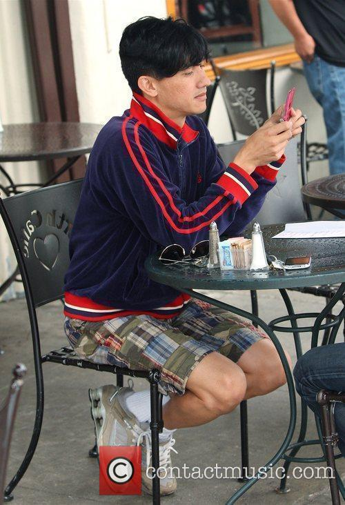 Bobby Trendy texting on his phone while dining...