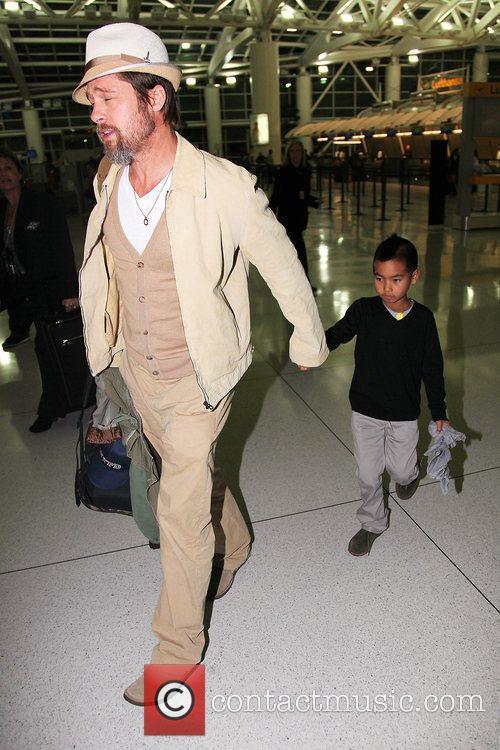 Brad Pitt and Maddox arrive at JFK International...